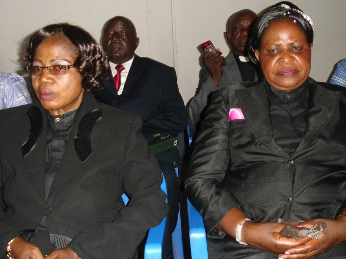 Ordination candidates Ngombe and Swana, backed by their husbands