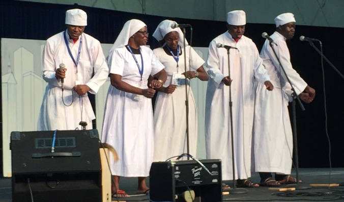 A choir from Kenya performs on the Global Village stage at Mennonite World Conference Assembly